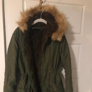 Green parka with faux fur hood